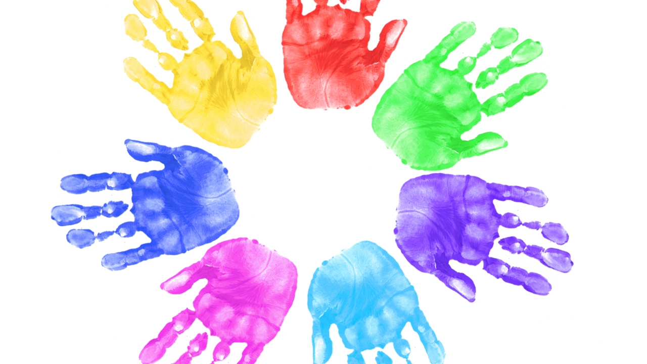 317840-hands-of-children-in-school-